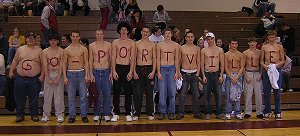 "Students at basketball game with ""Go Portville"" painted on them"