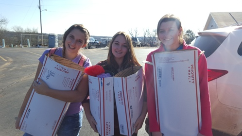 students holding parcel boxes