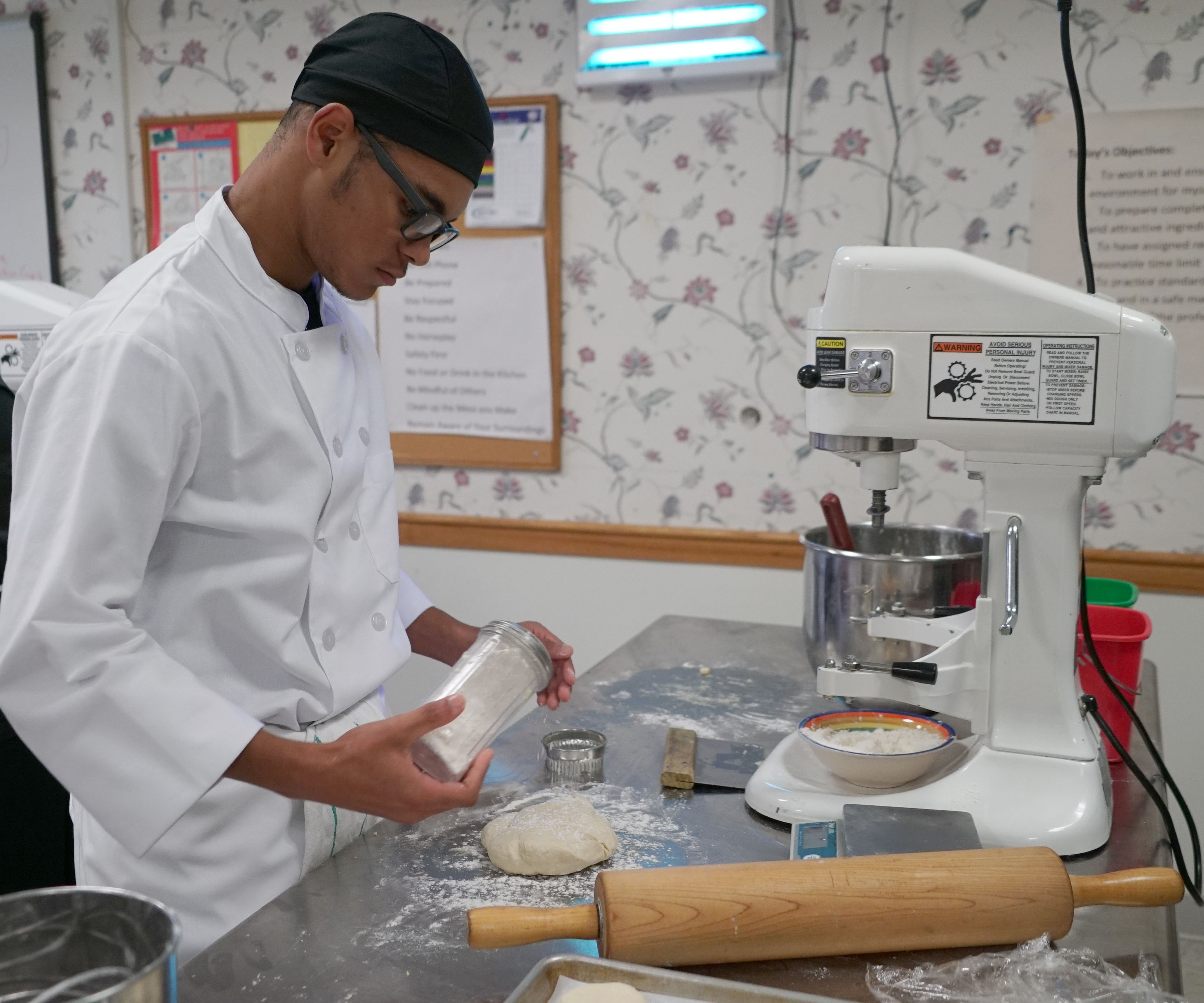 student working with dough